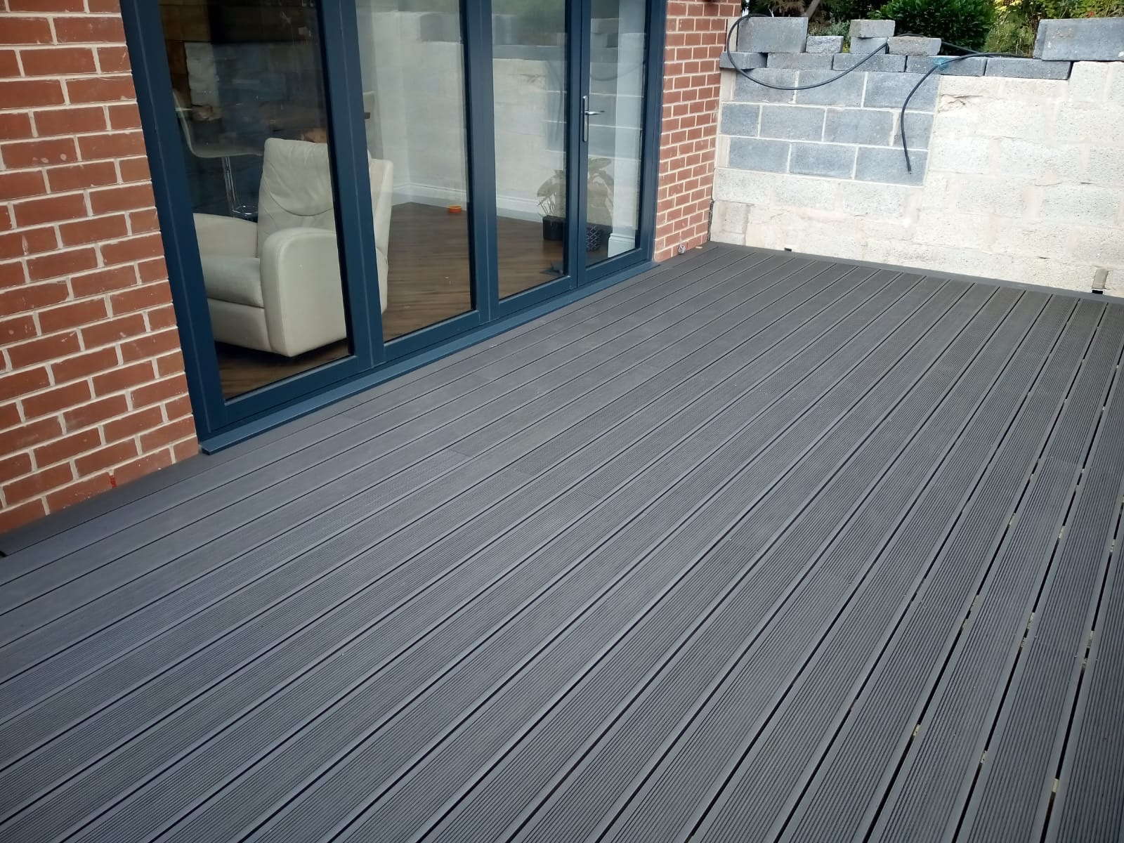 Composite decking delivered and installed by Spolding and Sons.